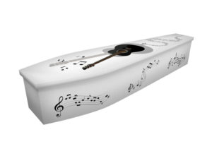 Cardboard coffin with an image of a black guitar and musical notes