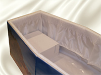 Crem film lining with a satin frill and cardboard headrest