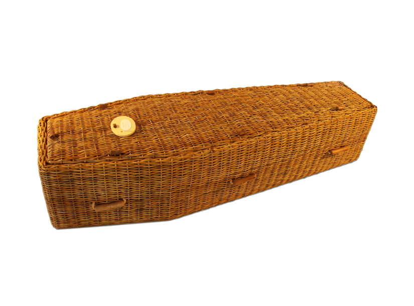 woven coffin made from golden wicker