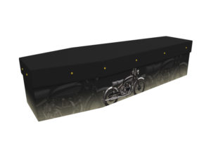 Cardboard coffin with an image of a black motorbike